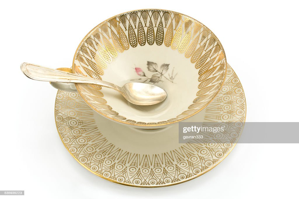 Antique porcelain tea cup isolated on white : Stock Photo