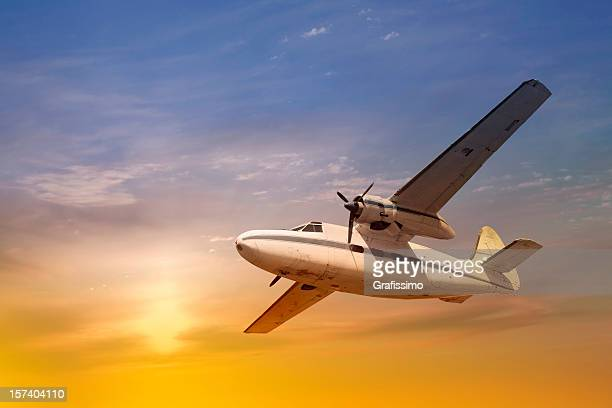 Antique propeller airplane at sunset