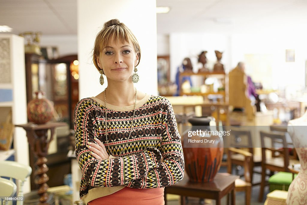 Antique shop owner in her shop : Stock Photo