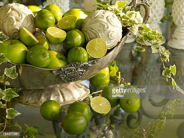 Antique silver bowl with limes