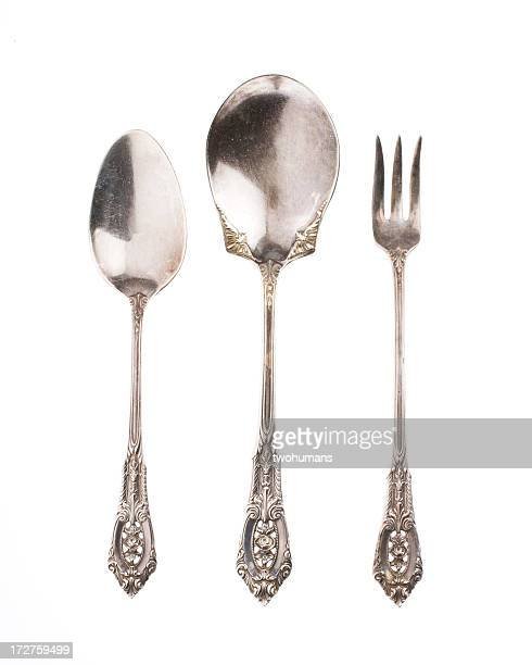 antique silver spoons and fork on white background - tablespoon vs teaspoon stock photos and pictures