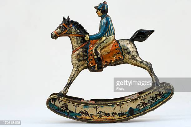 Antique small tin penny toy horse with rider.