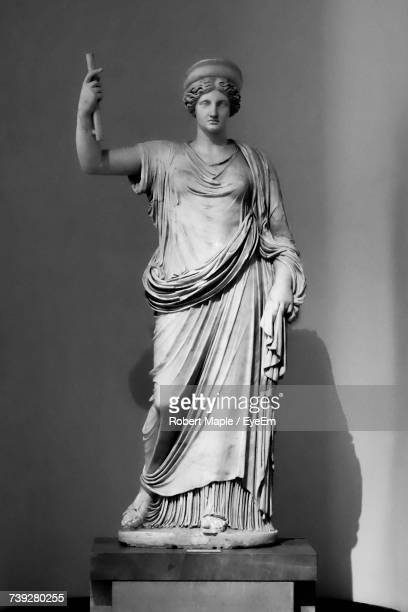 antique statue against wall - female likeness stock pictures, royalty-free photos & images