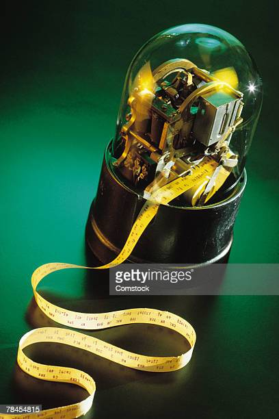 antique stock ticker tape machine - ticker tape stock pictures, royalty-free photos & images