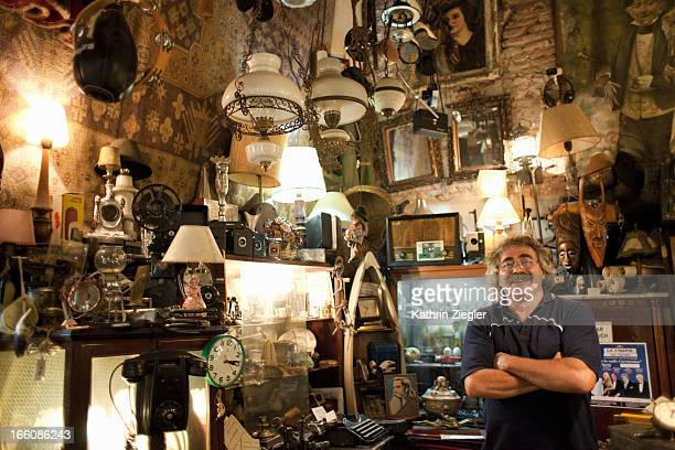 antique store owner in his shop - antique stock pictures, royalty-free photos & images