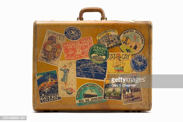 Antique suitcase with decals