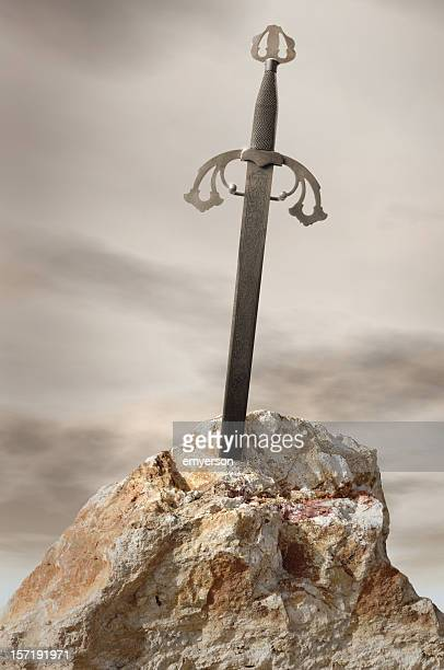 Antique sword stuck in stone rock