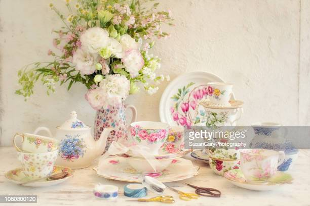 antique tea cups and lisianthus floral still life - sugar bowl crockery stock photos and pictures