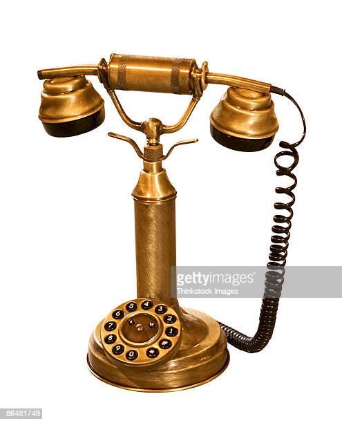 antique telephone - thinkstock stock-fotos und bilder