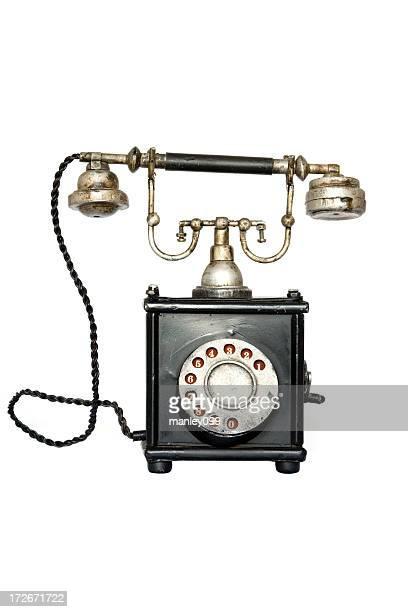 Ancien téléphone métaux et isolé