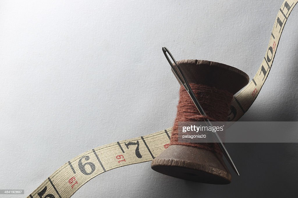 Antique Thread and Needle with Measuring Tape : Stock Photo