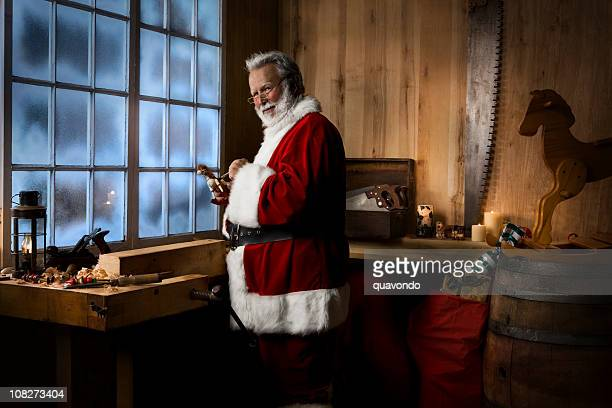 Antique Toy Making Shop with Santa Claus on Winter Night