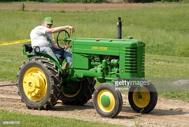 antique tractor pulling competition - john deere tractor stock photos and pictures