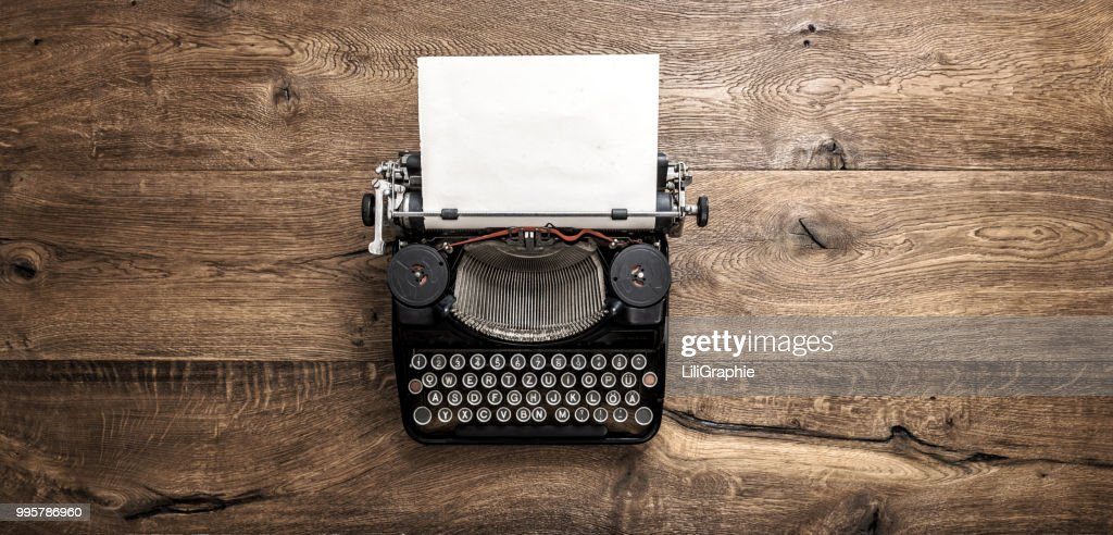 Antique typewriter grungy textured paper wooden background : Stock Photo