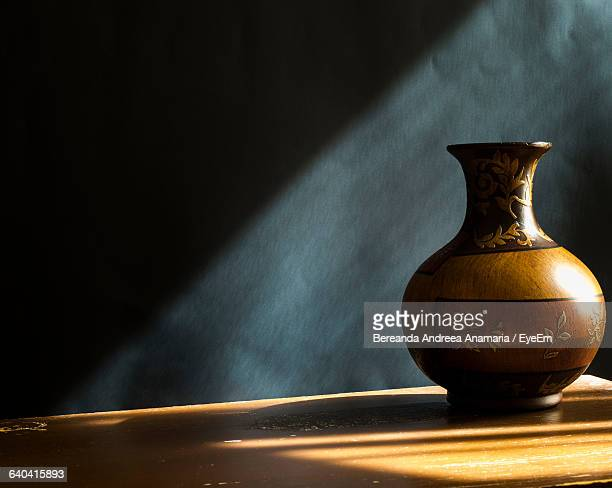 Antique Vase On Wooden Table At Home