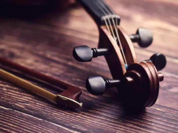 Antique violin on an old wooden floor