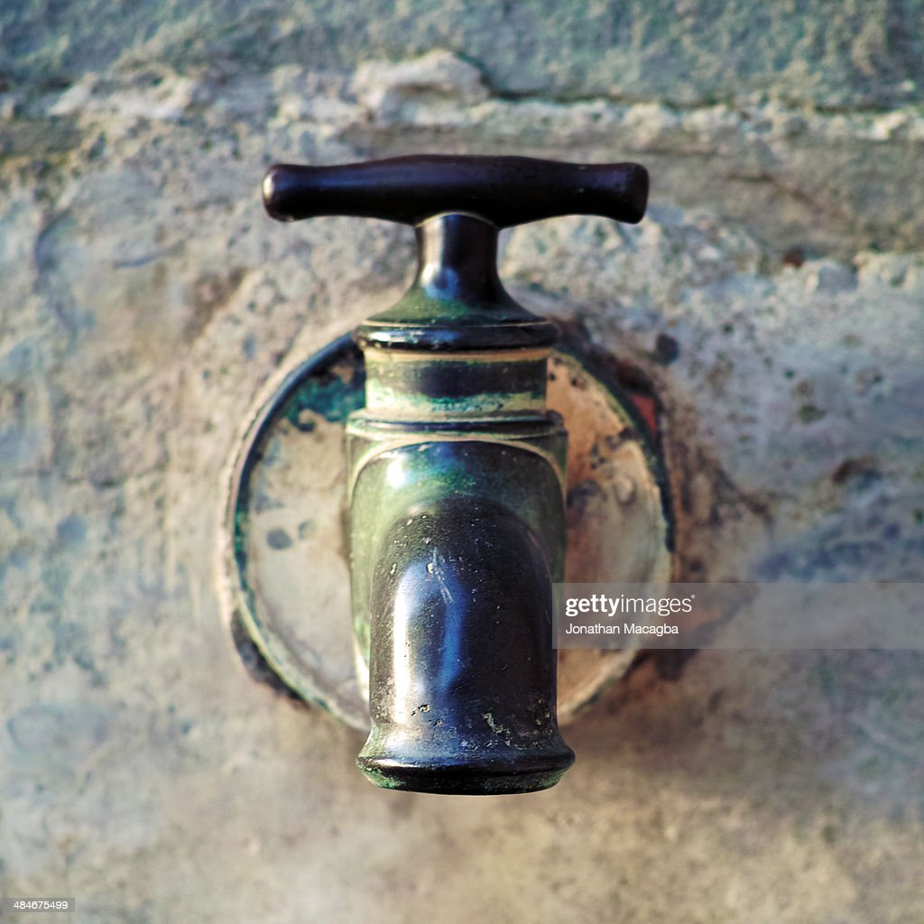 Antique Water Spigot Stock Photo | Getty Images