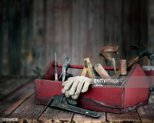 antique work tools in a toolbox - toolbox stock pictures, royalty-free photos & images