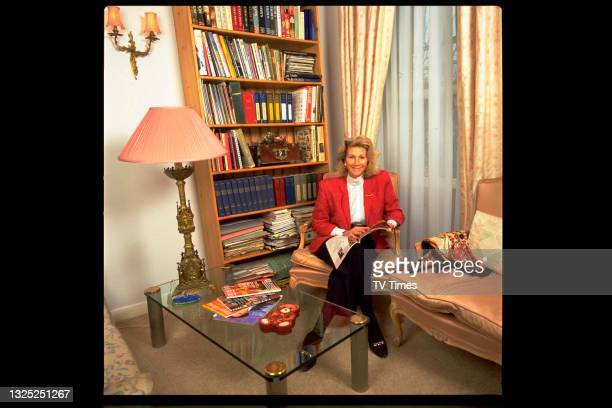 Antiques expert Bunny Campione, best known for her appearances on BBC series Antiques Roadshow, photographed at home, circa 1994.
