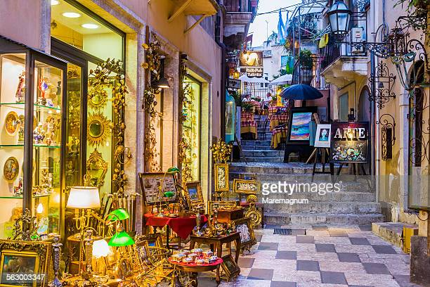 antiquities shop in an alley - taormina stock pictures, royalty-free photos & images