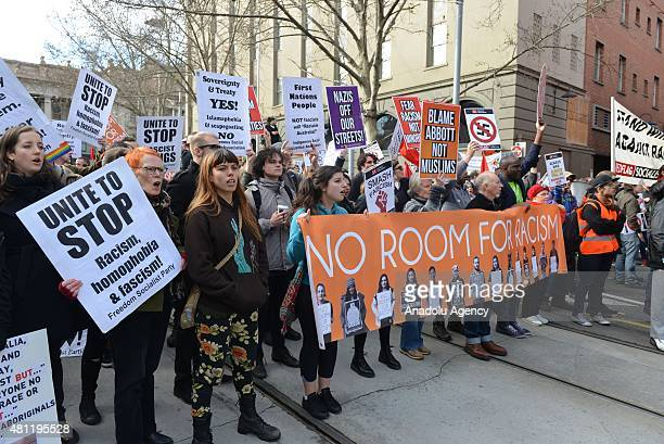 Antiracism activists chant slogans as antiIslam protesters stage rally in Melbourne Australia on July 18 2015 Hundreds of police were deployed in...