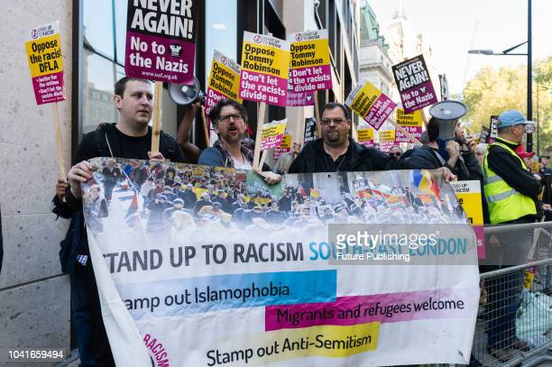 Antiracism and antifascism activists gather outside the Central Criminal Court in the City of London to protest against former English Defence League...