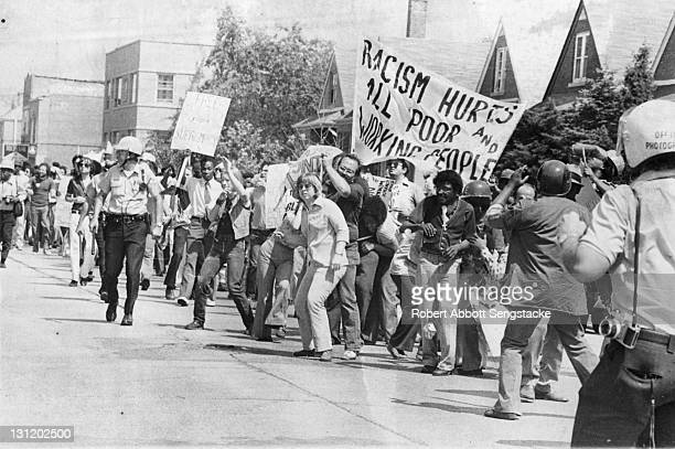 Antiracism demonstrators line the streets as they protest a potential neoNazi march Skokie Illinois 1977 or 1978