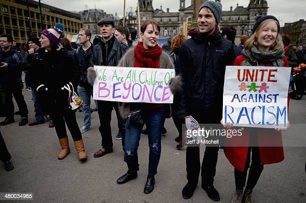 Antiracism demonstrators march through Glasgow on March 22 2014 in Glasgow Scotland The march and rally was organised by Unite Against Facism and is...