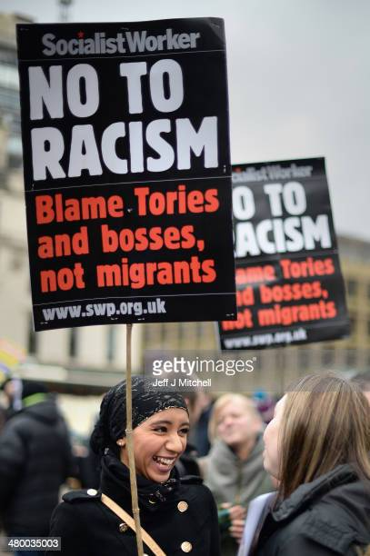 Antiracism demonstrators march through the city on March 22 2014 in Glasgow Scotland The march and rally was organised by Unite Against Facism and is...
