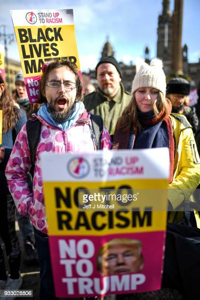 Antiracism demonstrators take part in a antiracism rally through the city centre on March 17 2018 in Glasgow Scotland The event organised by Stand up...