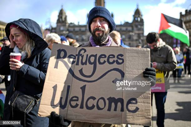 Antiracism demonstrators take part in a rally through the city centre on March 17 2018 in Glasgow Scotland The event organised by Stand up to Racism...