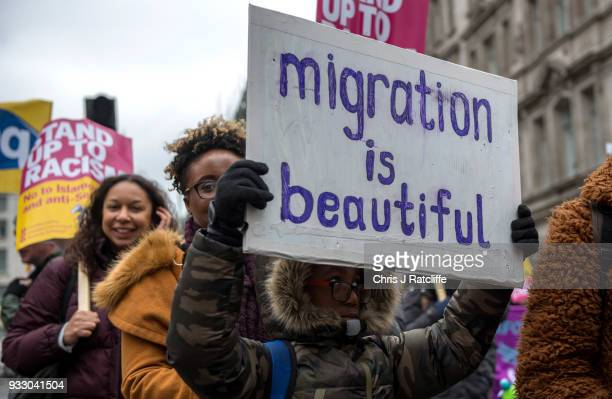 Antiracism demostrators hold placards and chant during a march against racism on March 17 2018 in London England The march is organised by the group...
