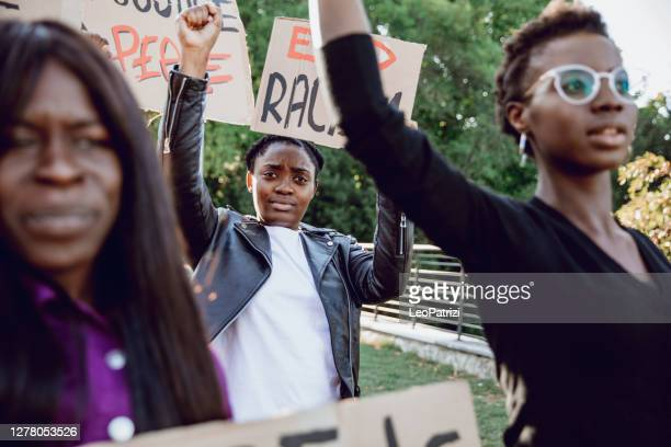 anti-racism protest - people together to say no to racism - police brutality stock pictures, royalty-free photos & images