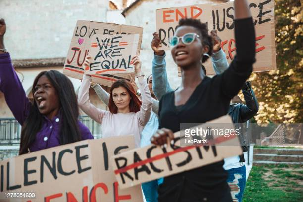 anti-racism protest - people together to say no to racism - racism stock pictures, royalty-free photos & images