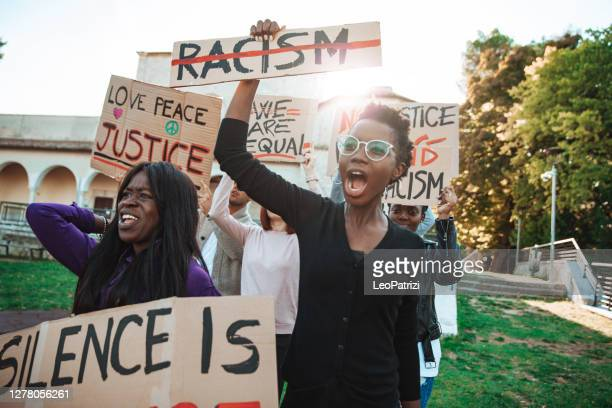anti-racism protest - people together to say no to racism - social movement stock pictures, royalty-free photos & images