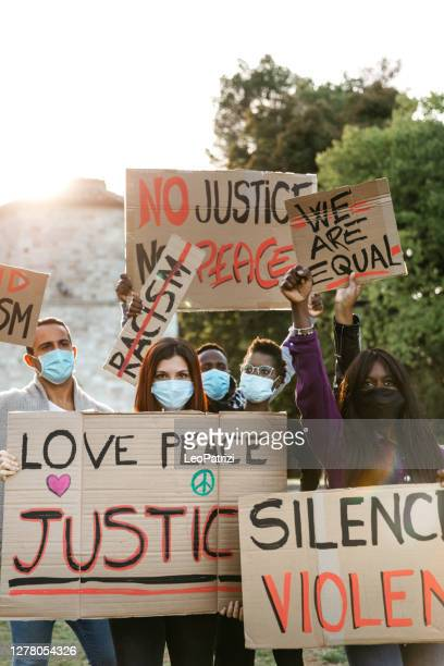 anti-racism protest with facefask to protect covid-19 pandemic spread - police brutality stock pictures, royalty-free photos & images
