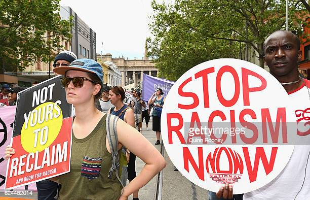 Antiracism protesters gather to counter protest against a Donald Trump victory rally outside State Parliament on November 20 2016 in Melbourne...
