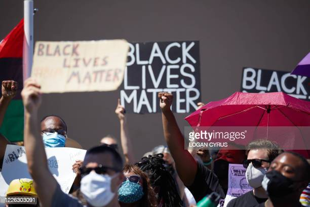 Antiracism protesters with the BurlingtonAlamance March For Justice and Community march in Graham North Carolina on July 11 2020 The Mayor of Graham...