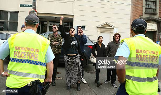 Antiracism protestors shout slogans outside the Chinese Consulate on May 30 2015 in Sydney Australia The rally was sparked by flyers distributed by...