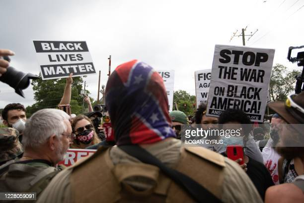 Anti-racist and anti-facist protesters orgranized by F.L.O.W.E.R, a frontline organization based in Atlanta to combat racism face off against far...