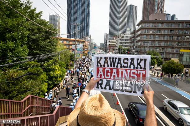"""Anti-racist holds a banner during a counter-protest rally against """"hate speech rally"""" in Nakahara, Kawasaki City, Kanagawa prefecture,..."""