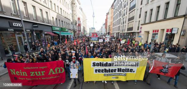 Antiracists protest against a far right demonstration organised around the slogan 'Merkel muss weg' in Berlin Germany 04 March 2017 The banners...