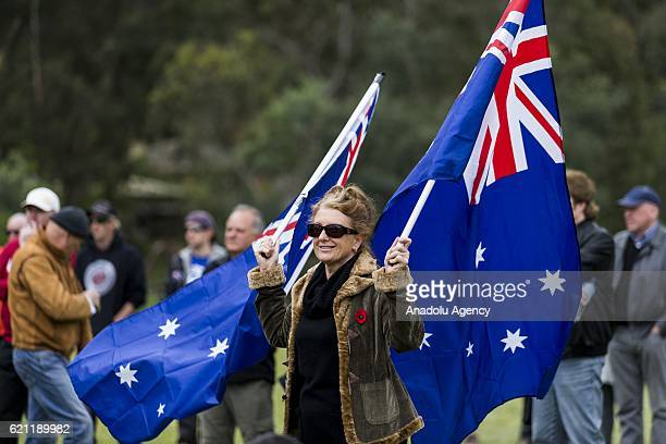 Antirefugee protesters march with posters and Australian flags during pro and anti refugee rallies in Eltham Melbourne Australia on November 05 2016...