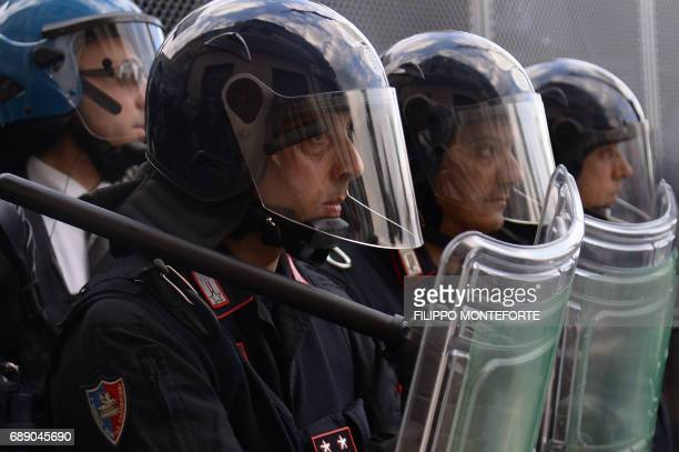 Antiriot carabinieri face protesters during a rally against the G7 Summit in GiardiniNaxos near the venue of the G7 summit of Heads of State and of...