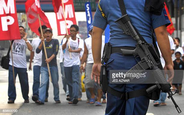 Antiriot police block protesters trying to march to a military camp in Manila on November 29 where rebel soldier and senator Antonio Trillanes are...