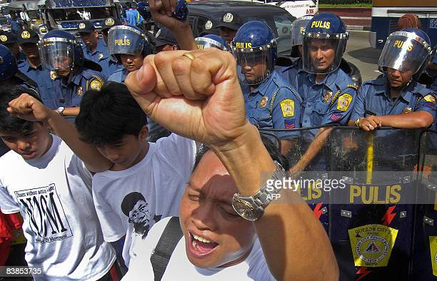 Antiriot police block protesters trying to march to a military camp in Manila on November 29 where rebel soldiers and senator Antonio Trillanes are...