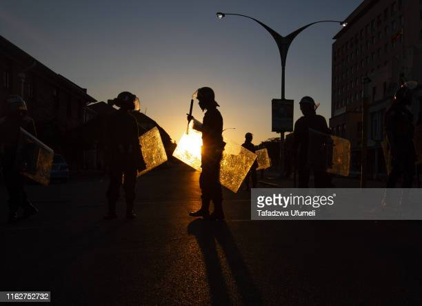 Antiriot police block the entrance to the Magistrates court after the Zimbabwe main opposition party Movement of Democratic Changes appeal against...
