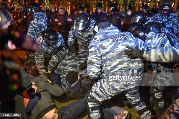 Antiriot police detain activists protesting against a plan to build an Orthodox cathedral at a construction site in a park in the Russian Urals city...
