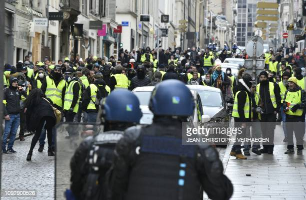 """Anti-riot police face """"Yellow Vest"""" protesters during clashes in a march on February 2, 2019 in Nancy, eastern France, called to pacifically protests..."""
