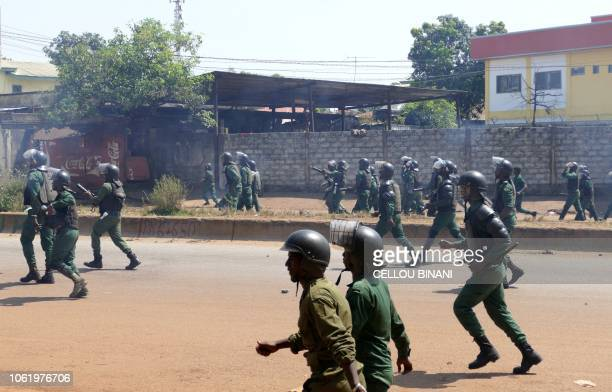 Antiriot police prepare to disperse Guinean opposition supporters during a demonstration against a series of bloody crackdowns on opposition...